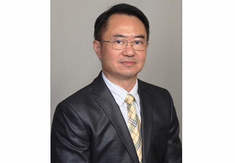 ERIC C. MAN  Your Financial Advisor